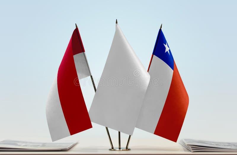 Vlaggen van Monaco en Chili royalty-vrije stock foto's