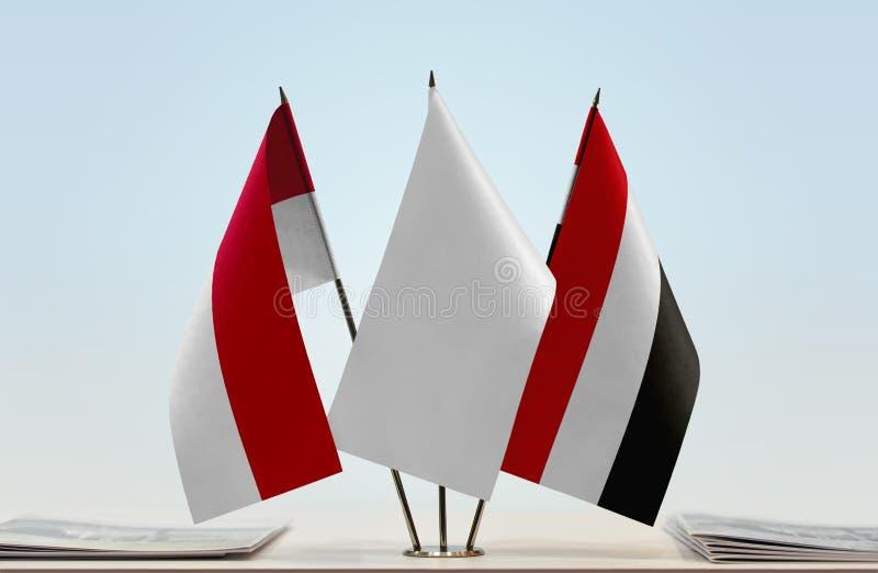 Vlaggen van Monaco en Yemen stock foto's
