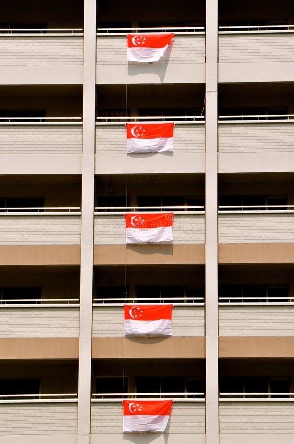 Vlaggen van Singapore voor de vieringen die van de Onafhankelijkheidsdag wordt getoond stock foto's