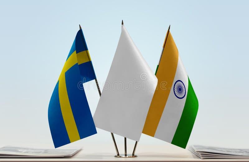 Vlaggen van Zweden en India stock fotografie