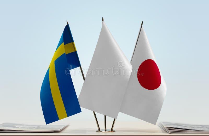 Vlaggen van Zweden en Japan royalty-vrije stock foto's