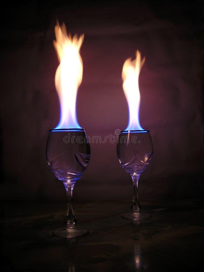 Vlam boven glazen. stock foto's