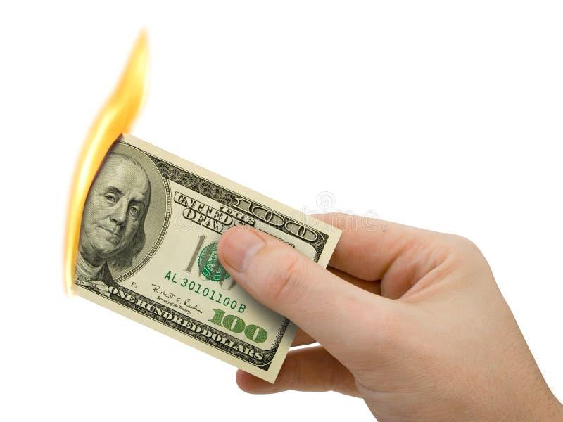 Vlammend in hand geld royalty-vrije stock afbeelding