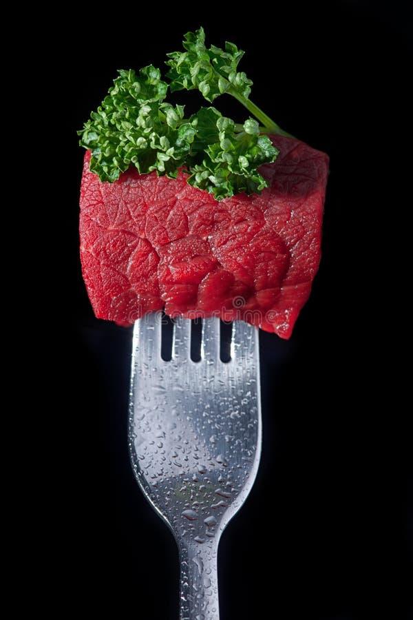 Vlees op een vork stock foto