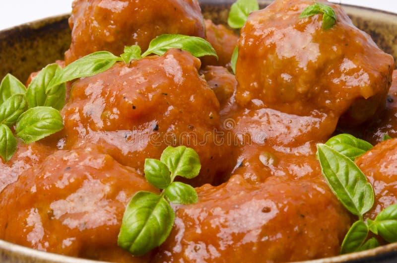 Vleesballetjes in tomatensaus stock afbeeldingen