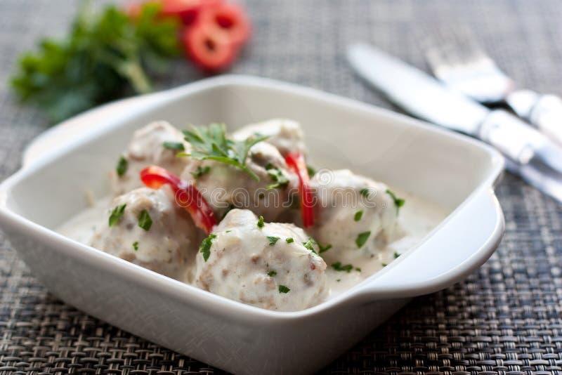 Vleesballetjes in witte saus royalty-vrije stock foto's