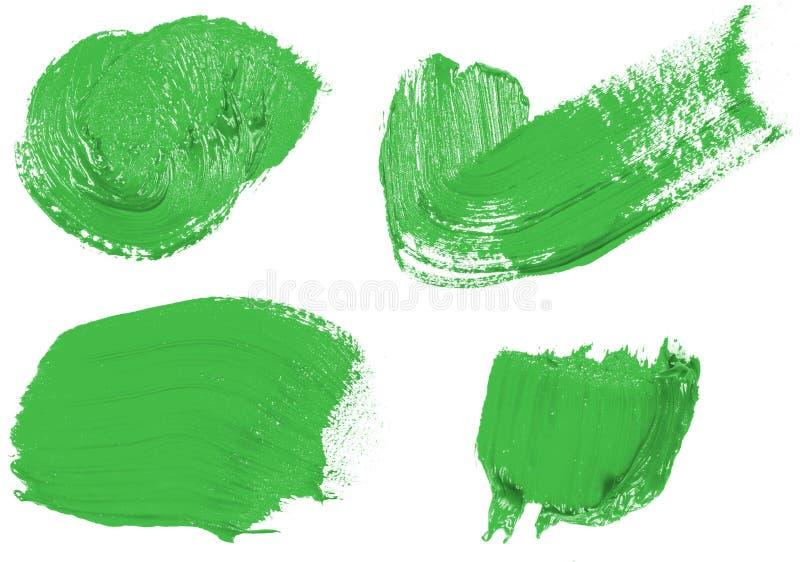 Vlek van olie groene verf op whit reeks stock foto's