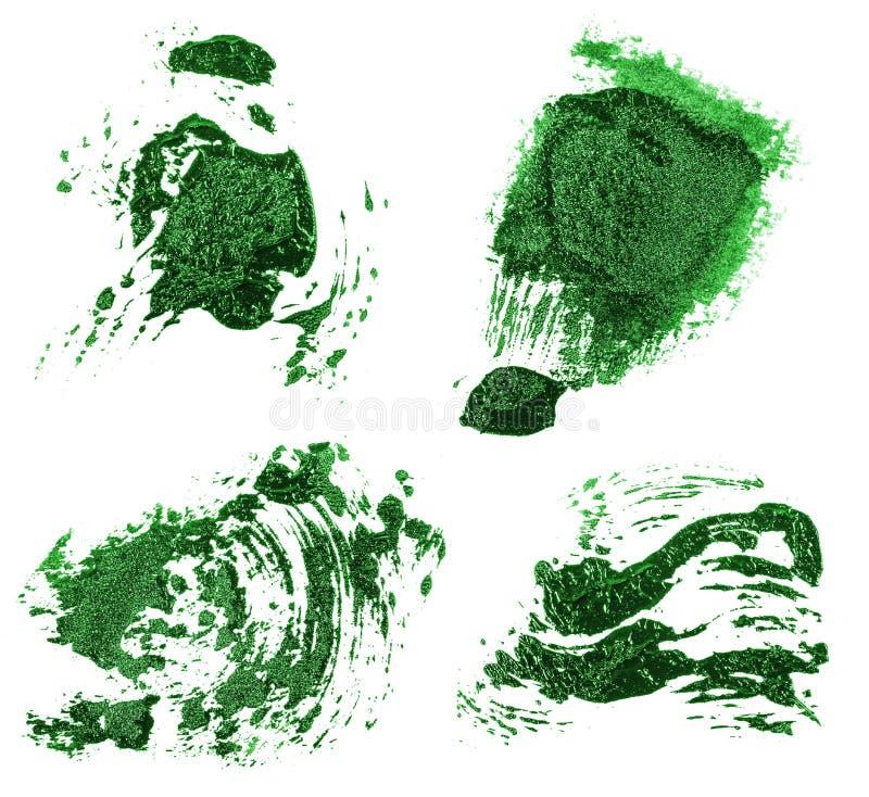 Vlek van olie groene verf op wit reeks stock afbeeldingen