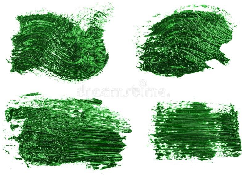 Vlek van olie groene verf op wit reeks stock afbeelding