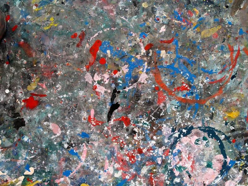 Vlekkleuren op tafelbladoppervlakte voor werkend kunstwerk, abstracte kleurrijke kunstachtergrond wordt gebruikt die royalty-vrije stock foto
