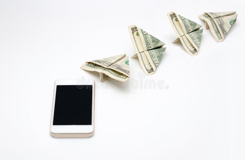Vliegend geld van mobiele telefoon royalty-vrije stock foto's
