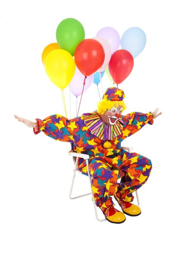 Vliegende Clown als Voorzitter van het Gazon stock foto