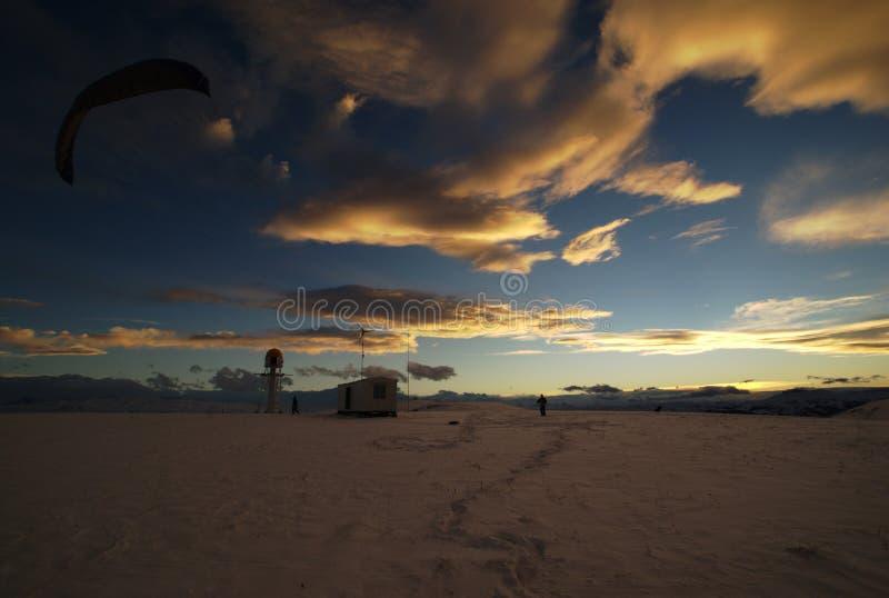 Vlieger in sneeuw deserе stock afbeeldingen