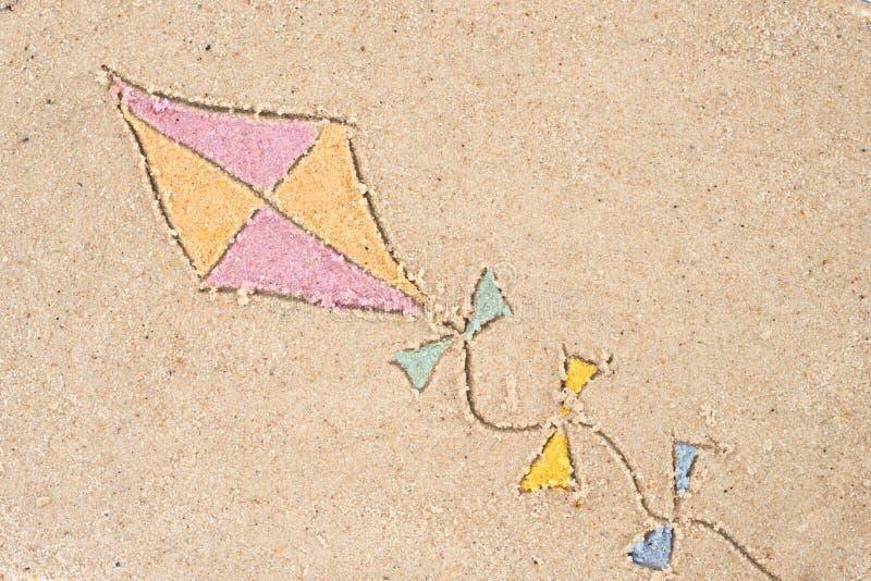 Vliegertekening in zand stock afbeelding