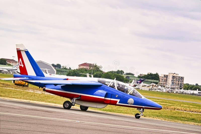 Vliegtuigvliegtuigen van Patrouille DE Frankrijk bij Franse internationale bijeenkomst royalty-vrije stock foto's