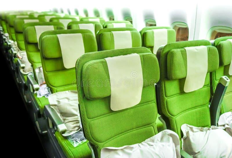 Vliegtuigzetels in cabine stock afbeelding