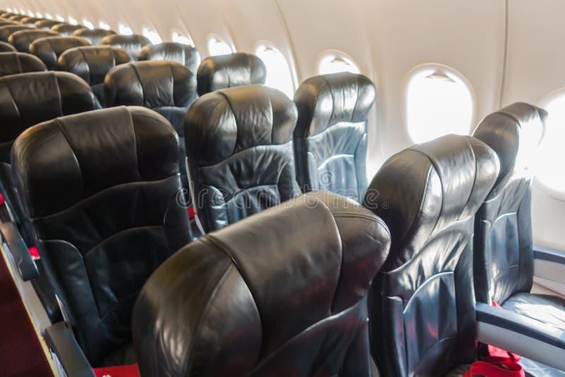 Vliegtuigzetels in de cabine stock afbeelding