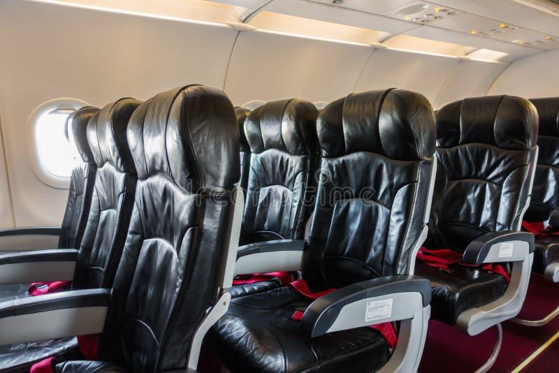 Vliegtuigzetels in de cabine stock afbeeldingen