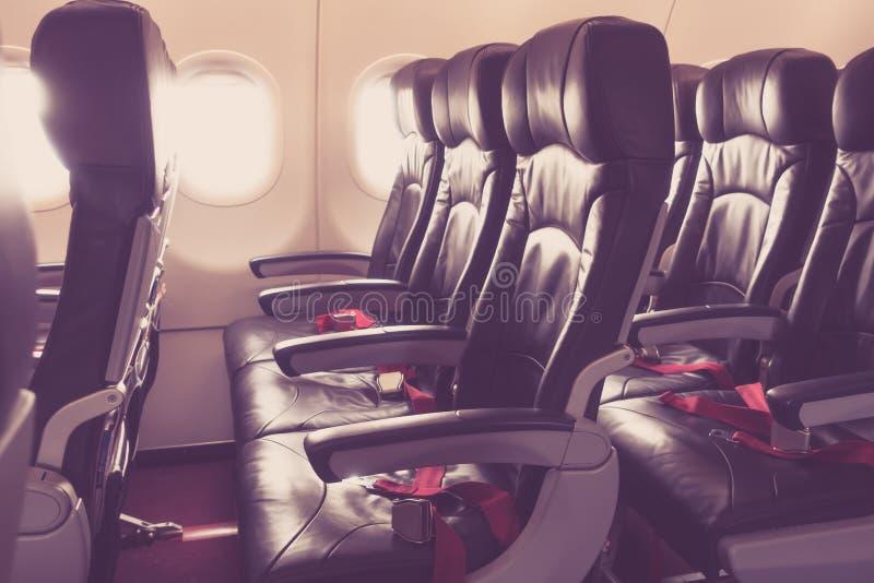 Vliegtuigzetels in de cabine (Gefiltreerde beeld verwerkte wijnoogst royalty-vrije stock afbeelding