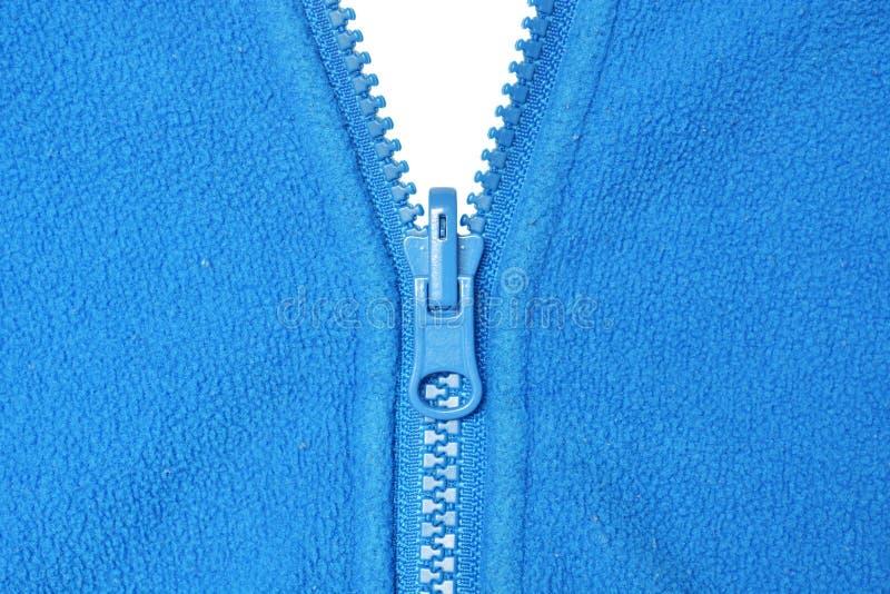 Vlies und blauer Reißverschluss stockfoto