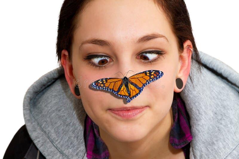 Vlinder op neus stock fotografie