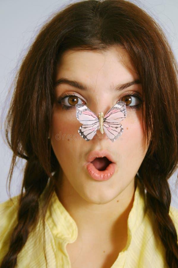 Vlinder op neus royalty-vrije stock afbeelding