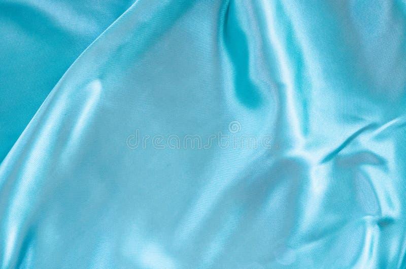 Vlot elegant blauw zijde of satijn stock afbeelding