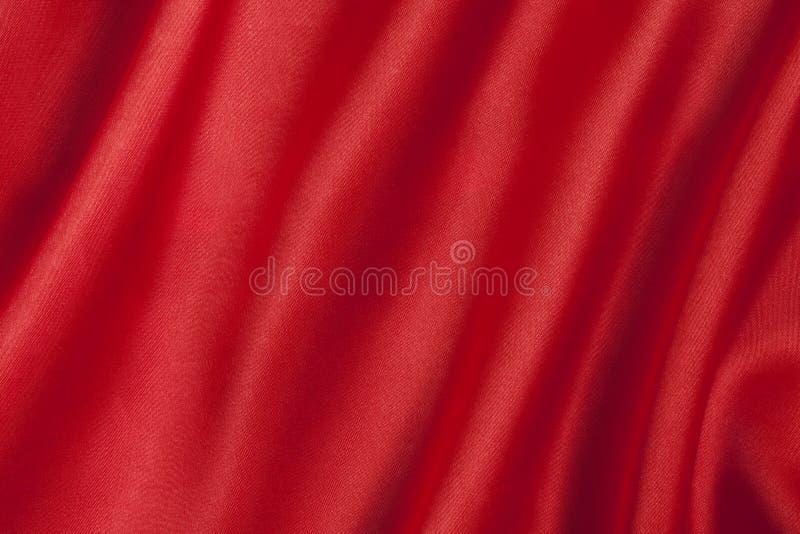 Vlotte rode satijnachtergrond royalty-vrije stock foto