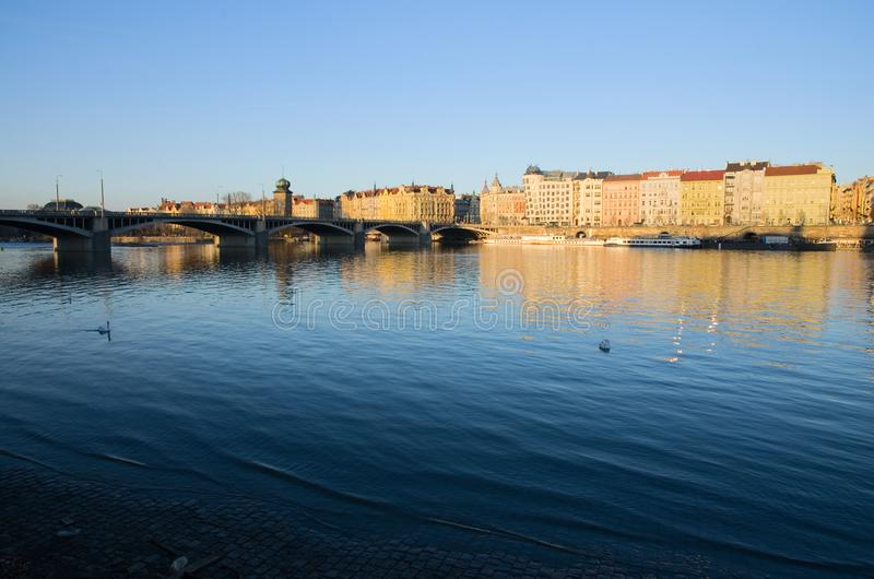 Vltava river with bridge and houses on embankment royalty free stock photography