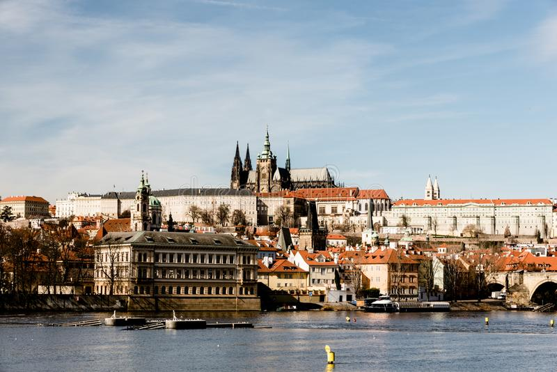 Vltava river, Mala Strana and Prazsky hrad castle in Praha city in Czech republic. During nice day with blue sky stock photos