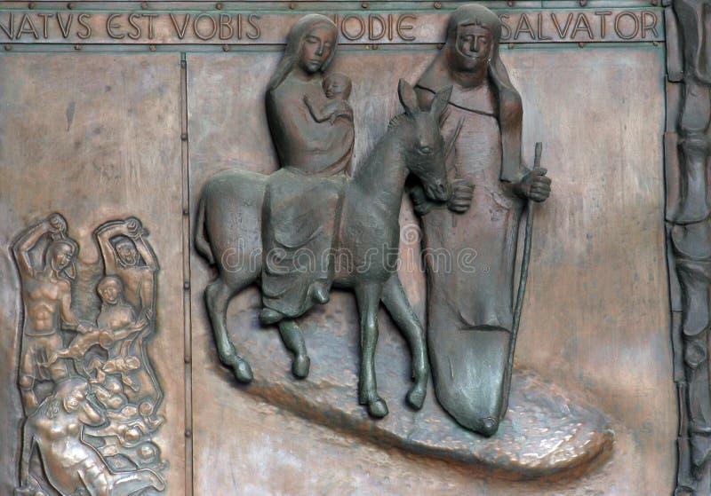 Vlucht aan Egypte, Deur van de basiliek van de Aankondiging, Nazareth stock fotografie
