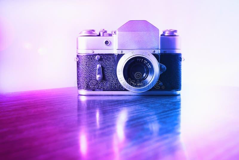Vntage pink and purple rangefinder camera background stock photo
