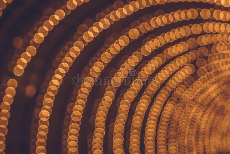 Voûte des lumières de bokeh Illumination de fête photographie stock