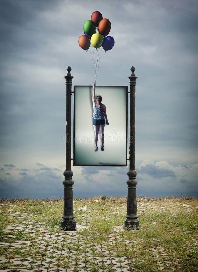 Voando com balões imagem de stock royalty free