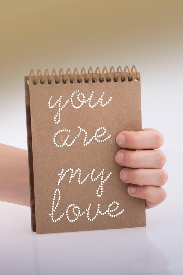 Você é meu texto do amor no caderno à disposição como o cocept do amor imagens de stock