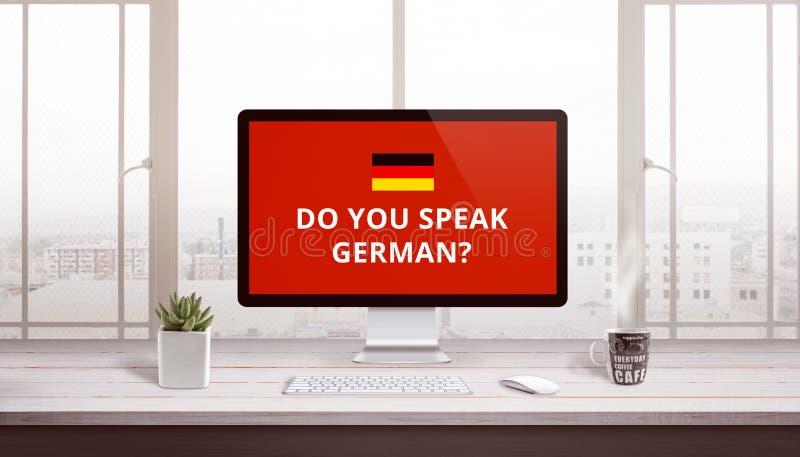 Você fala alemão na exposição de computador com uma bandeira de Alemanha fotos de stock