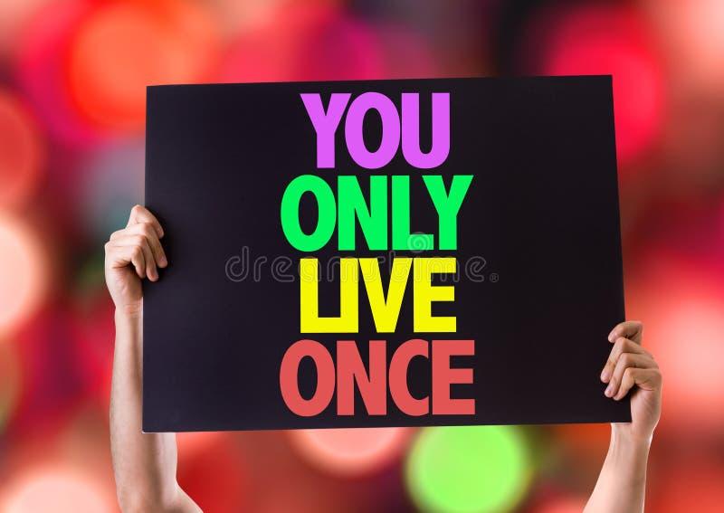 Você somente cartão de Live Once com fundo do bokeh fotos de stock