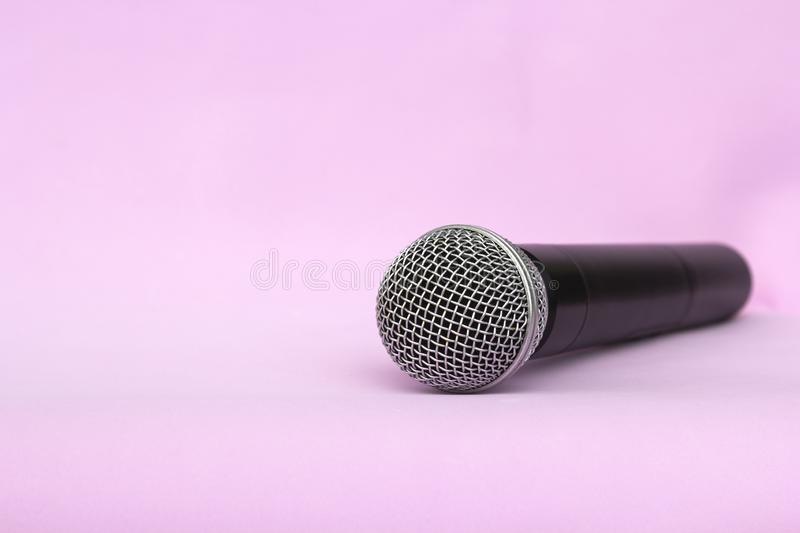 Vocal silver microphone wireless for audio recordings, karaoke on pink background.  stock photos