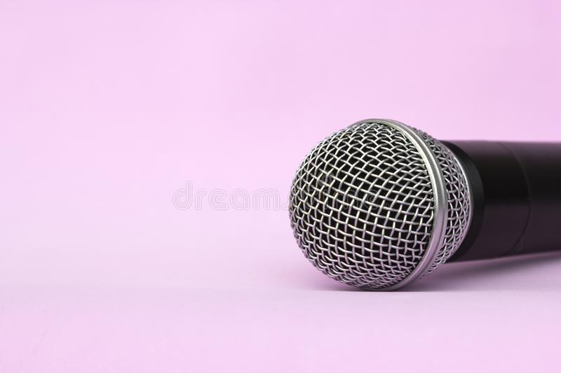 Vocal silver microphone wireless for audio recordings, karaoke on pink background.  royalty free stock image