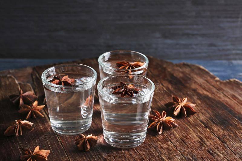 Vodka with anise on background. Vodka with anise on wooden background stock photography
