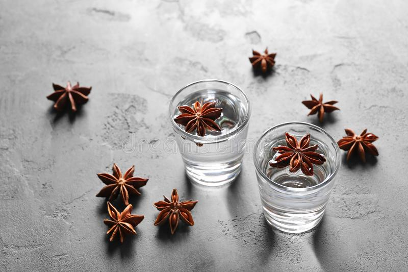 Vodka with anise on grey background. Vodka with anise on grey textured background stock images