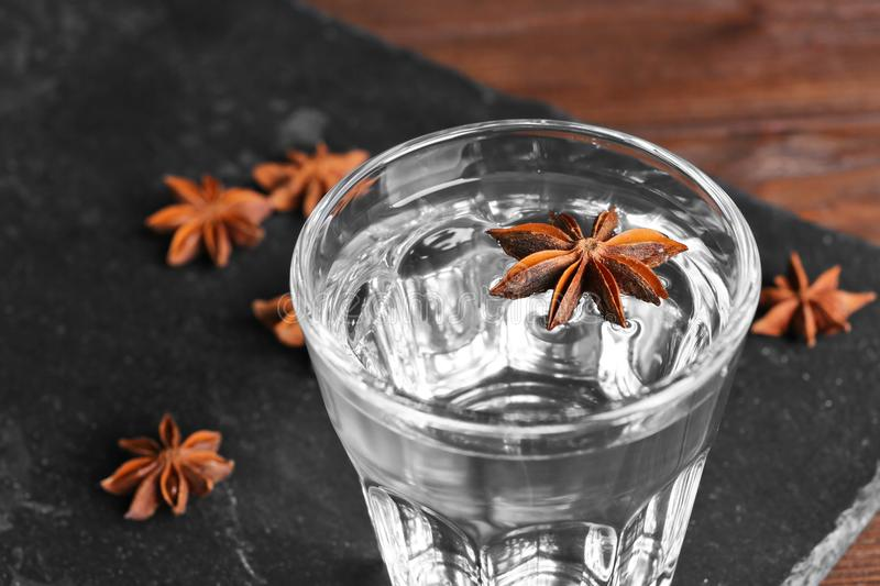 Vodka with anise on table. Closeup royalty free stock images