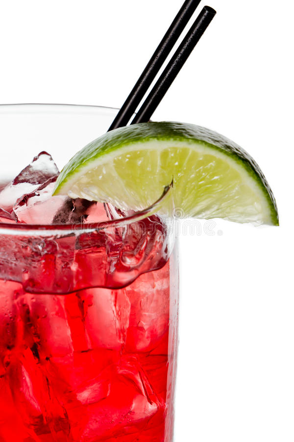 Vodka and cranberry or cape cod. Closeup of a cape cod cocktail or vodka cranberry isolated on a white background royalty free stock photo