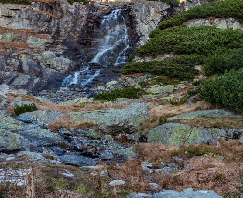 Vodopad Skok waterfall on Mlynicka dolina valley in Vysoke Tatry mountains in Slovakia. During nice autumn morning stock photos