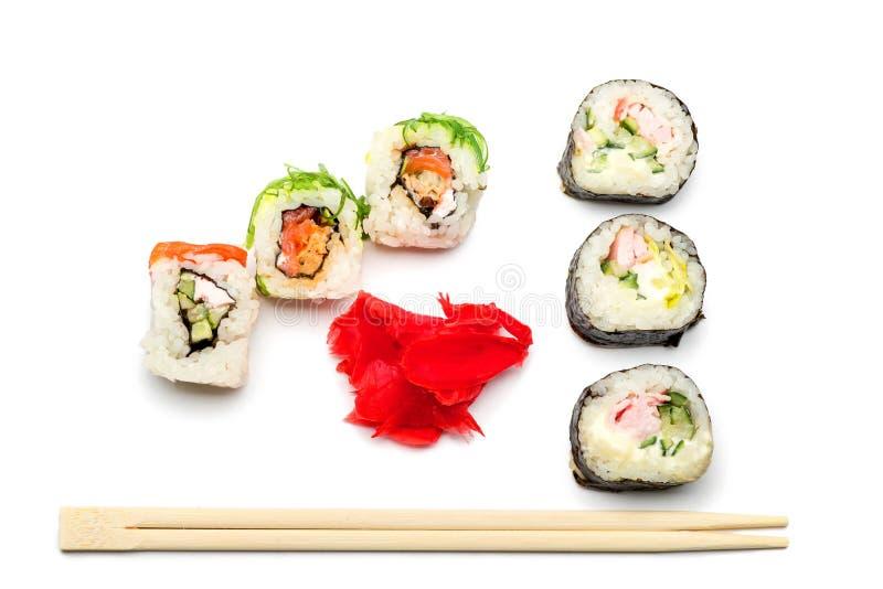 Voedsel abstracte achtergrond Op het witte vliegtuig lig broodjes of sushi, stock foto