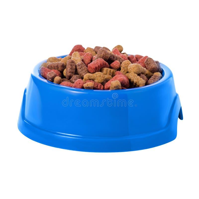 Voedsel voor honden en katten in een blauwe kom royalty-vrije stock foto