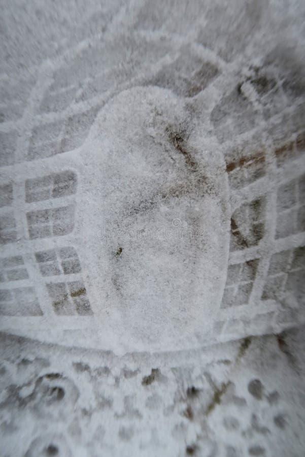 Voetafdruk op sneeuwclose-up royalty-vrije stock afbeelding