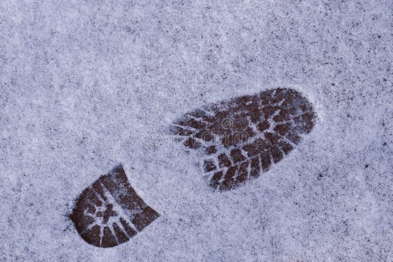 Voetafdrukken in de sneeuw Concept Sluit omhoog royalty-vrije stock foto's