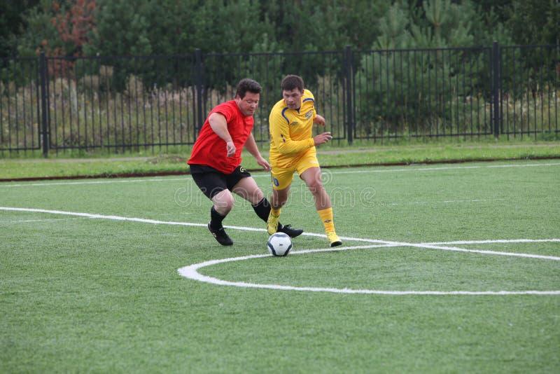 Voetbal, mensen, spel, sport, bal, de concurrentie royalty-vrije stock foto