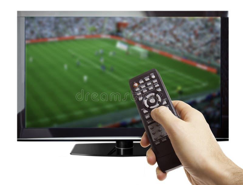 Voetbal op TV stock foto